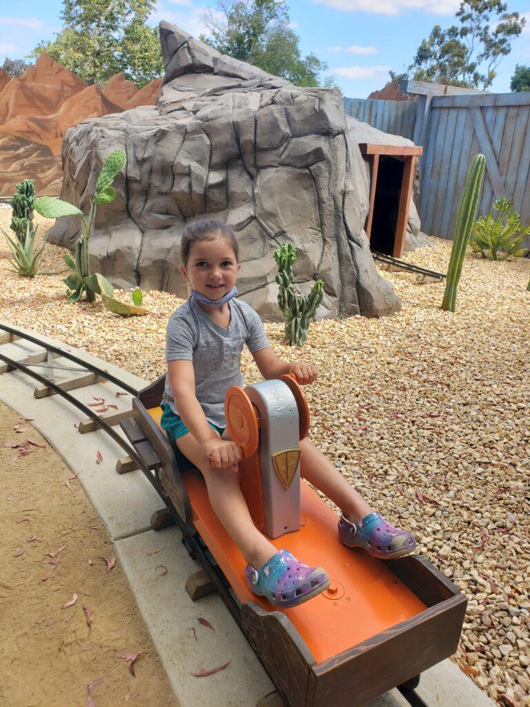 Little girl on Protector's Journey Handcart Ride at El Dorado Frontier