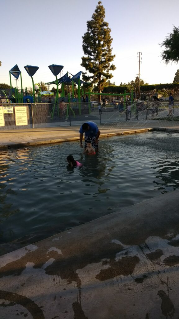 family in a wading pool