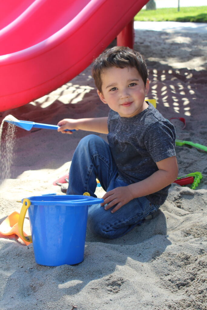 toddler playing at park preschool