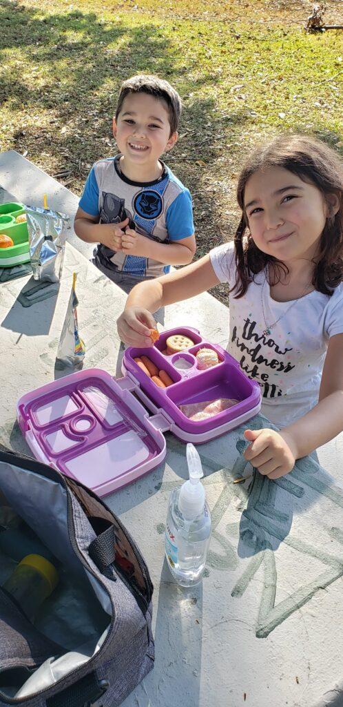 kids eating at picnic table
